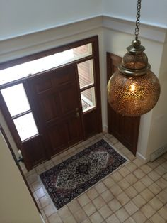 """The Portland, ME piece installed in its final home! They ended up going with a """"BulBrite Nostalgic"""" light bulb, which gives out an interesting warmth! A work of art.  #Moroccan #Luxury #Lighting. www.mycraftwork.com"""