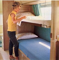 Unlike the earlier fold-down permanent bunk beds that replaced the overhead cabinets, these cable suspended bunk beds work in conjunction with the overhead cabinents so both can be installed in the trailer for greater functionality. The second cable is mostly hidden behind the Big Hair.