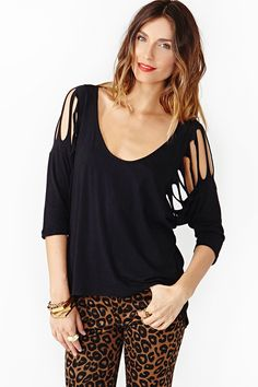 Shredded Dolman Tee: Hang tough in this awesome black tee featuring shredded shoulders and dolman sleeves. Deep scoop neckline, asymmetric hem. Oversized fit. Looks killer with faded cutoffs and a neon beanie! By Nasty Gal.