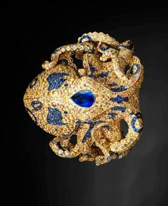 Jack du Rose Octopus in Yellow Gold, Yellow, Orange and Blue Sapphire, Cognac, Champagne and White Diamond, and Black Opal. | Gorgeous Ring