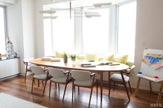 dining room built in bench seating oval dining table mid century modern chairs apartment house new york city nyc midtown