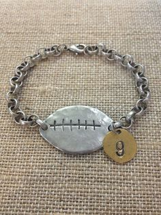 Hey, I found this really awesome Etsy listing at http://www.etsy.com/listing/154256111/football-bracelet-pewter