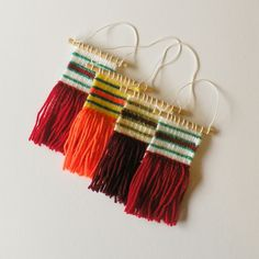 These mini woven wall hangings are the perfect addition to any Christmas Tree this festive season. #weaving #woven #wovenwallhanging #wallhanging #etsy #handmade #craft #gift #christmas #christmasdecorations