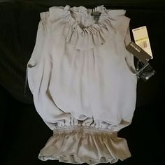 Cute dressy top size 4, Kenneth Cole Reaction 100% polyester she'll and lining. New with tags, color grey Kenneth Cole Reaction Tops Blouses