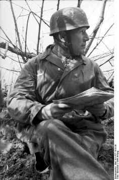 Monte Cassino, Italy. German paratrooper with Iron Cross and map. January 1944. Propaganda photo.