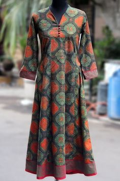 a perfect maxi anarkali with ajrakh print in flowy style! this anarkali has mangalgiri fabric used in sleeves & border with fabric potli buttons in the fr Pakistani Dresses, Indian Dresses, Indian Outfits, Kurta Patterns, Dress Patterns, Indian Attire, Indian Ethnic Wear, Salwar Designs, Blouse Designs