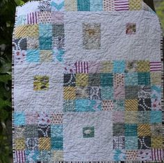 Making your first baby quilt pattern can be intimidating, but this easy tutorial on the Sweetly Scrappy Baby Quilt is a huge source of help and inspiration to quilting beginners. Check out this easy-to-follow guide to learn how to make a baby quilt out of your prettiest scrap quilt fabrics. You'll be amazed when you turn what you thought was leftover into a beautiful display of softly-colored strips. Take advantage of these cute pastel strips and create a tiny block pattern for a perfect-...