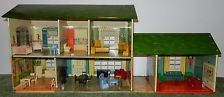 Used to have a tin doll house somewhat like this.