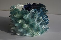 """LaGrif Bijoux. Kate McKinnon """"Contemporary Geometric Beadwork""""  The website for this pin is in Italian."""