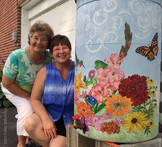 The artists with our finished creation. Rain Barrel, Promote Your Business, Artists, Graphic Design, Flowers, Painting, Rain Water Collector, Artist, Painting Art