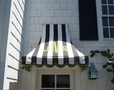 Awning . black and white trimmed in green scallops, LOVE this, notice the monogram
