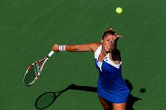 Pauline Parmentier of France serves against Petra Kvitova of the Czech Republic during their women's singles third round match on Day Five of the 2012 US Open