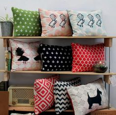 Cushions knitted and cotton. Scottie dog and fantails.