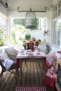 I just love this.  It reminds me of my Aunt Milly's.  She lived on the Jersey Shore and had this terrific front porch where we always used to sit and eat  lunch.  This just looks homey and welcoming...like coming home:-)