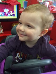 The after shots and story of the little man's first haircut. It wasn't all smiles!