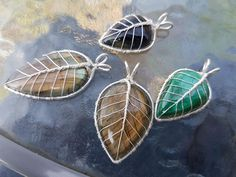 Just a bunch of gemstone leaf pendants that I wrapped (labradorites, malachite and tiger's eye). #wirejewelry