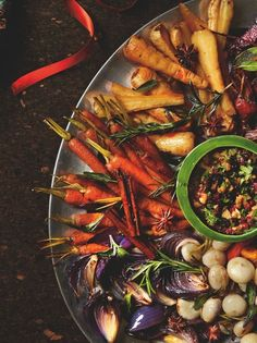 Yotam Ottolenghi's roast winter vegetable platter with walnut and barberry salsa.