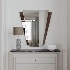 Art Deco mirror. 1920s and 1930s style frameless wall mirror thats interesting…
