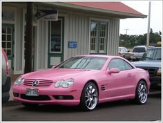 pink Mercedez parked in front of the post office in Makawao town, Maui in Hawaii.