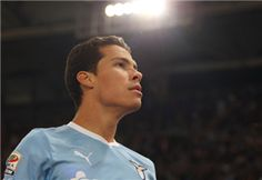 Hernanes of SS Lazio celebrates after scoring the penalty during the Serie A match between SS Lazio and AS Roma at Stadio Olimpico on October 16, 2011 in Rome, Italy.