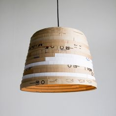 I can't understand how a recycled cardboard lampshade costs over two hundred and fifty quid!