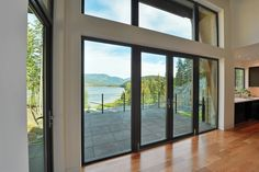 Patio doors are the most popular aspect of any residential place. They offer convenient access whilst making unhindered views that overflow interior places with natural light. Sliding Door Panels, Sliding Cabinet Doors, Pivot Doors, Sliding Glass Door, Tilt And Turn Windows, Windows And Doors, Secret Walls, Modern Patio Doors, Residential Windows