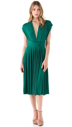 This is the dress I bought which is convertible and it can be worn like the other two dresses I pinned before this. What color is it? I want everyones opinion.
