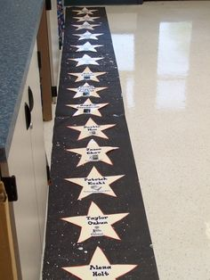 Clutter-Free Classroom: Hollywood Theme Classrooms   {2011 Edition} Kids could line up on stars. Maybe have them numbered rather than names so they could change each day.