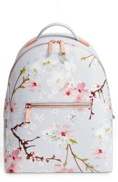Ted Baker London Flower Print Leather Backpack. Sleek and contemporary, this Ted Baker London backpack made from finely grained leather in a sweet cheery blossom print will add polish to your downtown or college style. Rose-goldtone hardware minimally details the sized-down silhouette, while a top handle and adjustable shoulder straps give it carrying versatility. #affiliate