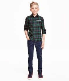 5-pocket pants in washed stretch twill. Adjustable elasticized waistband (sizes 8-12Y), zip fly, and ultra-slim legs.