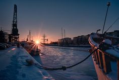 Boats anchored by the Aura river at winter with Swan of Finland vessel in the background - Jarmo Piironen (@JamoImages) | Twitter