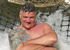 Aracaju, Brazil, Dan Trepanier catching sun and current on a catamaran net - Fun! - Photo by Ernani Oliveira