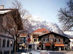 Garmisch-Partenkirchen, Germany. Beautiful murals painted on the outside of buildings, cattle herded through the streets, and beautiful mountains.