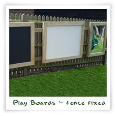 PLay boards fixed to a fence