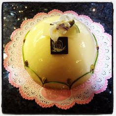 """Amalfi-""""A pistachio base with limoncello cremosa and a lemon Bavarian cream with a thin layer of vanilla sponge cake soaked in limoncello liqueur. """""""