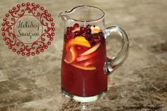 Holiday Sangria is a sweet wine cocktail loaded with fruit and juices that's a perfect drink for the holidays! Make it ahead of time to serve later! Christmas Drinks, Holiday Drinks, Party Drinks, Cocktail Drinks, Holiday Treats, Fun Drinks, Yummy Drinks, Holiday Recipes, Alcoholic Drinks