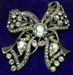 Eisenberg A rhinestone bow brooch, circa 1940s.