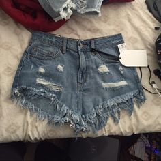 New medium washed denim shorts New with tags, medium washed denim shorts, tag says size medium but fits like a small. Waist: 27 inches, hip: 38 inches, length: around 9.5 inches, rise: 11 inches Jeans
