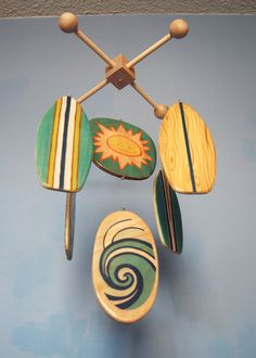 Surfboard baby mobile in teals and blues with orange accent.