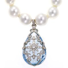 Victoria by Erica Courtney    The lovely and lavish Victoria charm is comprised of a truly exceptional pear shaped aquamarine, draped in a ravishing platinum and diamond floral design. This is the perfect necklace to wear for your most special celebrations and keep within the family to pass down for generations.