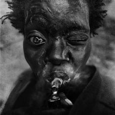 Photographer: Lee Jeffries, a self-taught photographer who is crusading to bring attention to the plight of the homeless    Latoria. Overtown, Miami, Fla. Feb. 6, 2012.