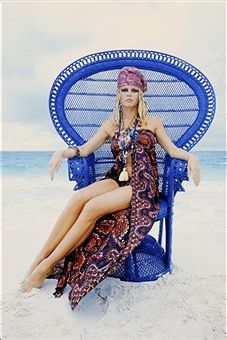 Portrait of French actress Brigitte Bardot sitting on a chair on the beach in October 1968 in Southern France.