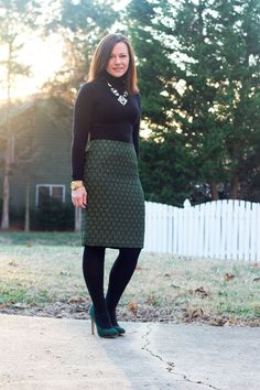 Winter work outfit: green pencil skirt, black turtleneck and tights