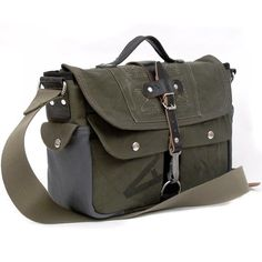 Olive military messenger bag, made from a recycled German Army navy-kitbag and a used grey navy submarine leather jacket. Inside there are 2 useful slip-pockets with a olive waterproof Hi-Tech lining fabric. Outside there 3 pockets one with a zip ( under the flap ), leather grab handle