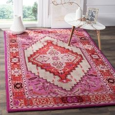 Ideal for any space in need of an eclectic makeover, these rugs from Safavieh's Bellagio Collection radiate Bohemian-chic flair. Expertly handmade of premium wool with almost a half-inch pile, these r