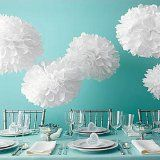 Easy step-by-step instructions to make giant paper flowers.
