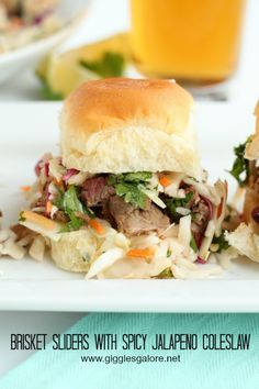 The ultimate tailgate food Brisket Sliders with Spicy Jalapeno Coleslaw #gametimegrilling #ad