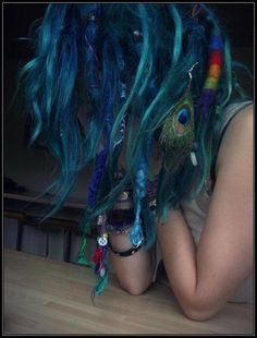 I love the peacock feather, it matches nicely with her hair color.