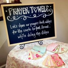 Adorable dish towel keepsake idea for a wedding shower! Have guests write a sweet message or prayer with fabric markers onto cotton fabric. The fabric messages are then sewn onto the ends of dish towels and the couple can hang them in their kitchen.