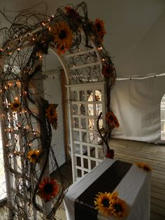 Fall arch decor  Sunflower and grapevine arch for wedding ceremony by Tarabrook Events  Fall altar decor